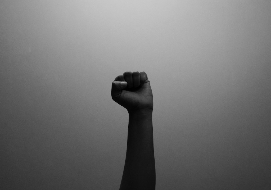 A student raises fist in black power salute.