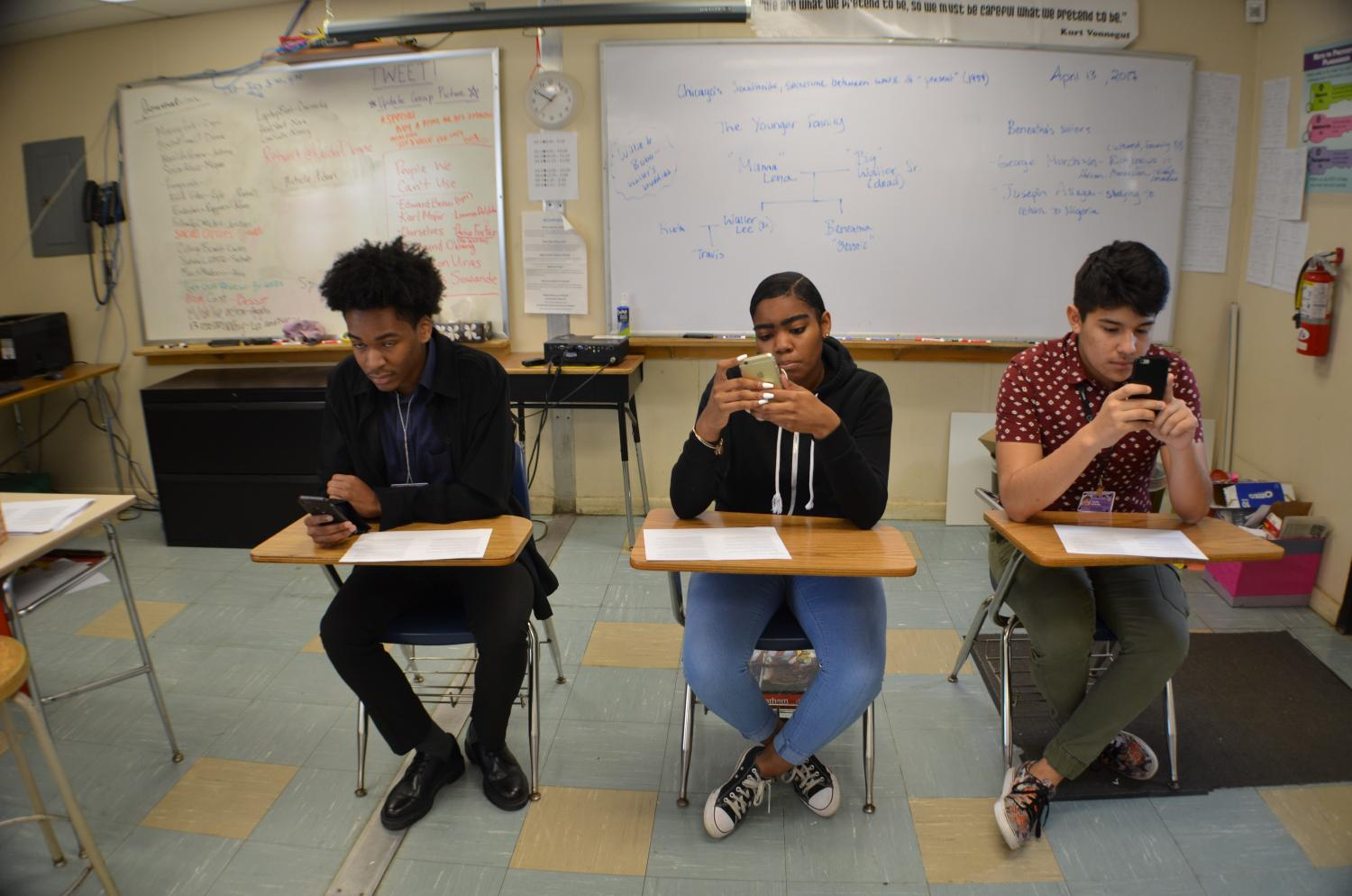 A staged demonstration of ERHS students using their phones.