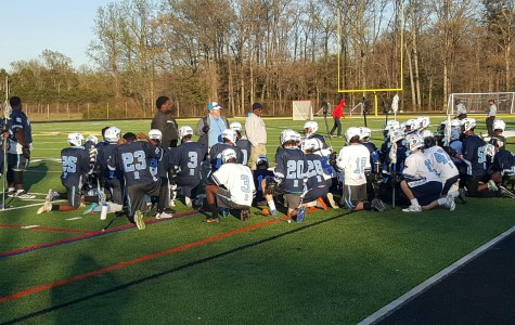 Raiders receive instruction during halftime of their game.