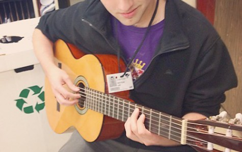 Senior Jan Knutson plays his instrument of choice, the guitar.