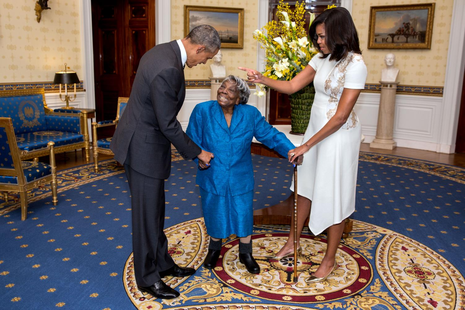 Barack Obama, Michelle Obama, and Virginia McLaurin celebrate Black History Month festivities