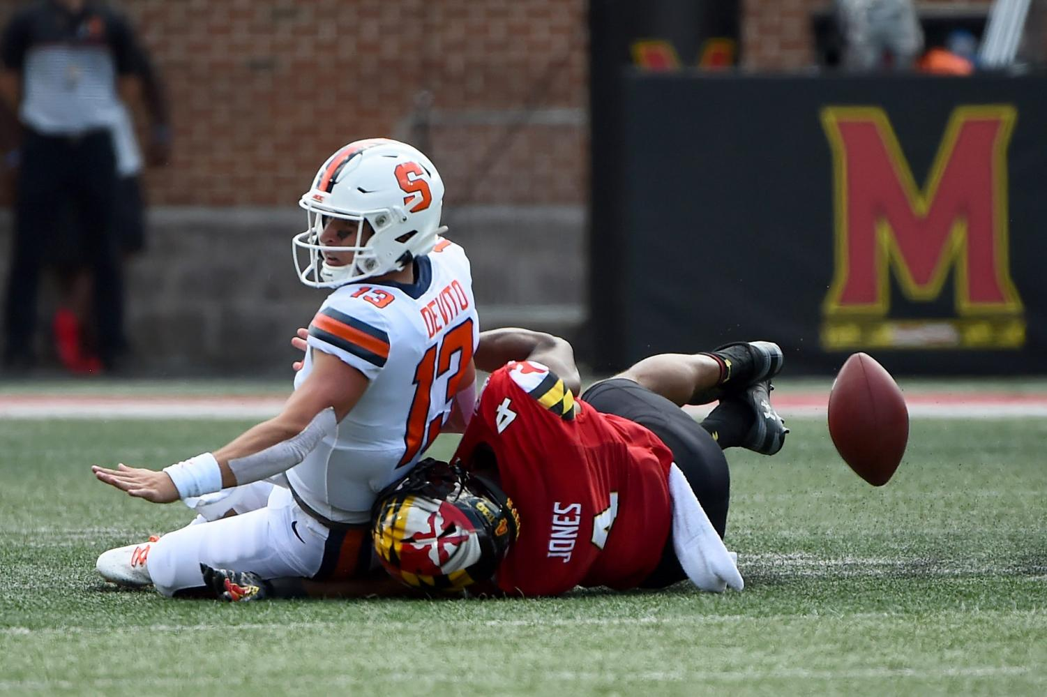 Maryland Terrapins linebacker Keandre Jones (4) forces Syracuse Orange quarterback Tommy DeVito (13) to fumble during the first half of an NCAA college football game, Saturday, Sept. 7, 2019, in College Park, Md. (AP Photo/Will Newton) Associated Press