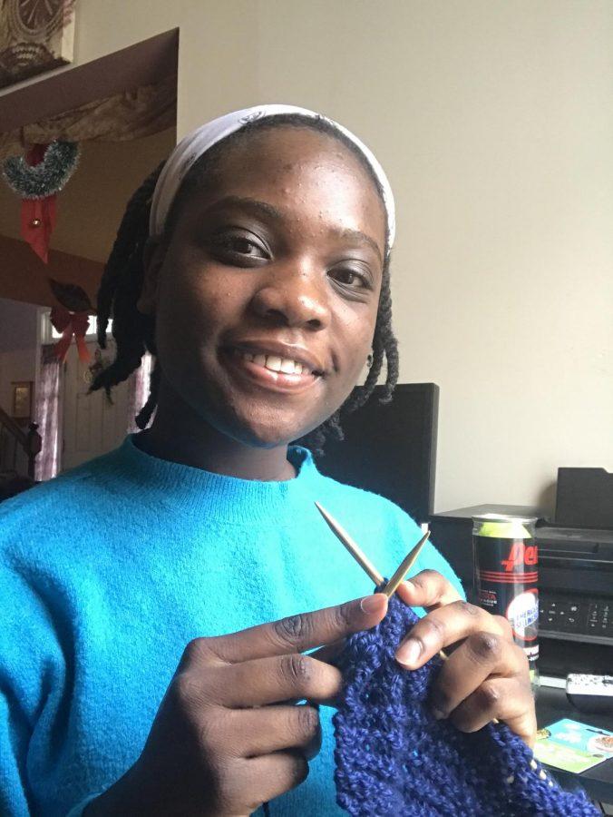 Kelsey Afoakwa knitting a scarf. Photo courtesy of Kelsey Afoakwa