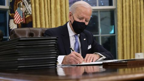 46th President of the United States Joseph R. Biden signs executive orders on his first day in office