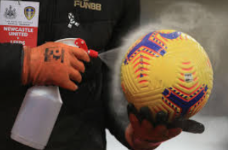 A soccer ball being disinfected.
