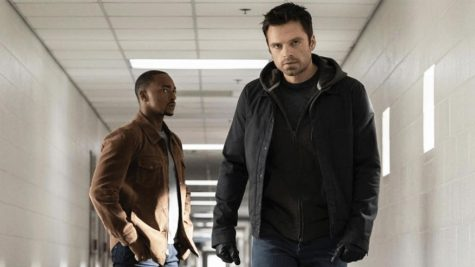 Anthony Mackies Sam Wilson stands behind and looks with doubt at Sebastian Stans Bucky Barnes as he walks to talk to the man who brainwashed him in The Falcon and The Winter Episode 3 Power Broker. Photo courtesy of Disney